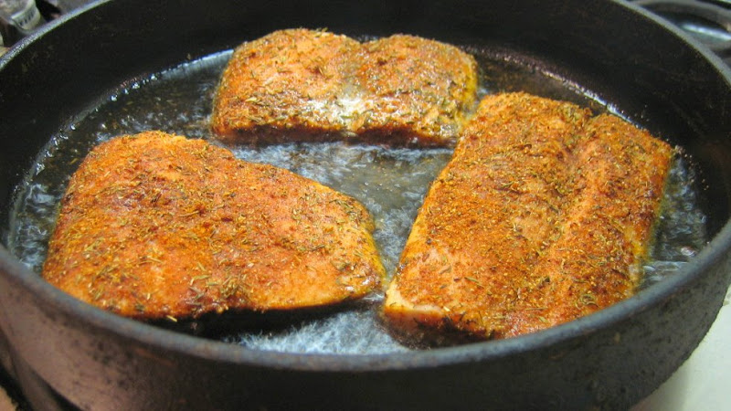 Make sure to use a heavy pan so the spices dont burn before they have a chance to caramelize and form a crust on the outside of the fish.