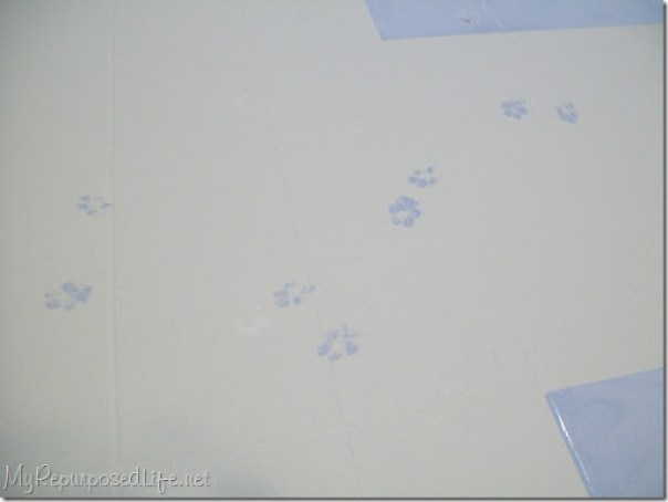 oops! paw prints on painted kitchen floor