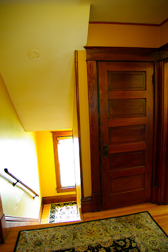 Looking from the 2nd floor bathroom toward the stair well - the closed door leads up to the master bedroom