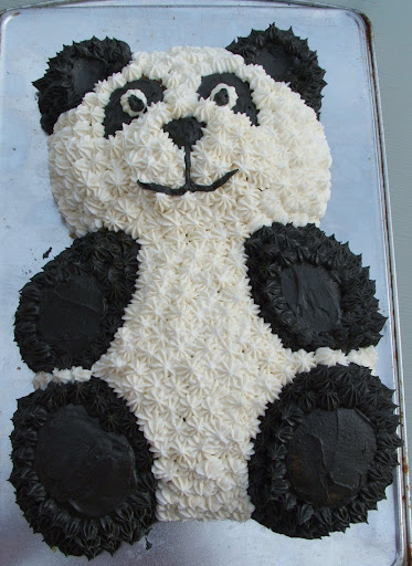 Brie has developed a love for all things Panda so most of her gifts had a panda on them...the cake was just a butter cake with vanilla and chocolate frosting dyed black
