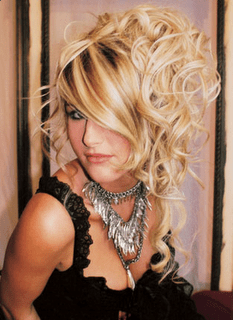 Modern messy updo hairstyle with light curls 2010