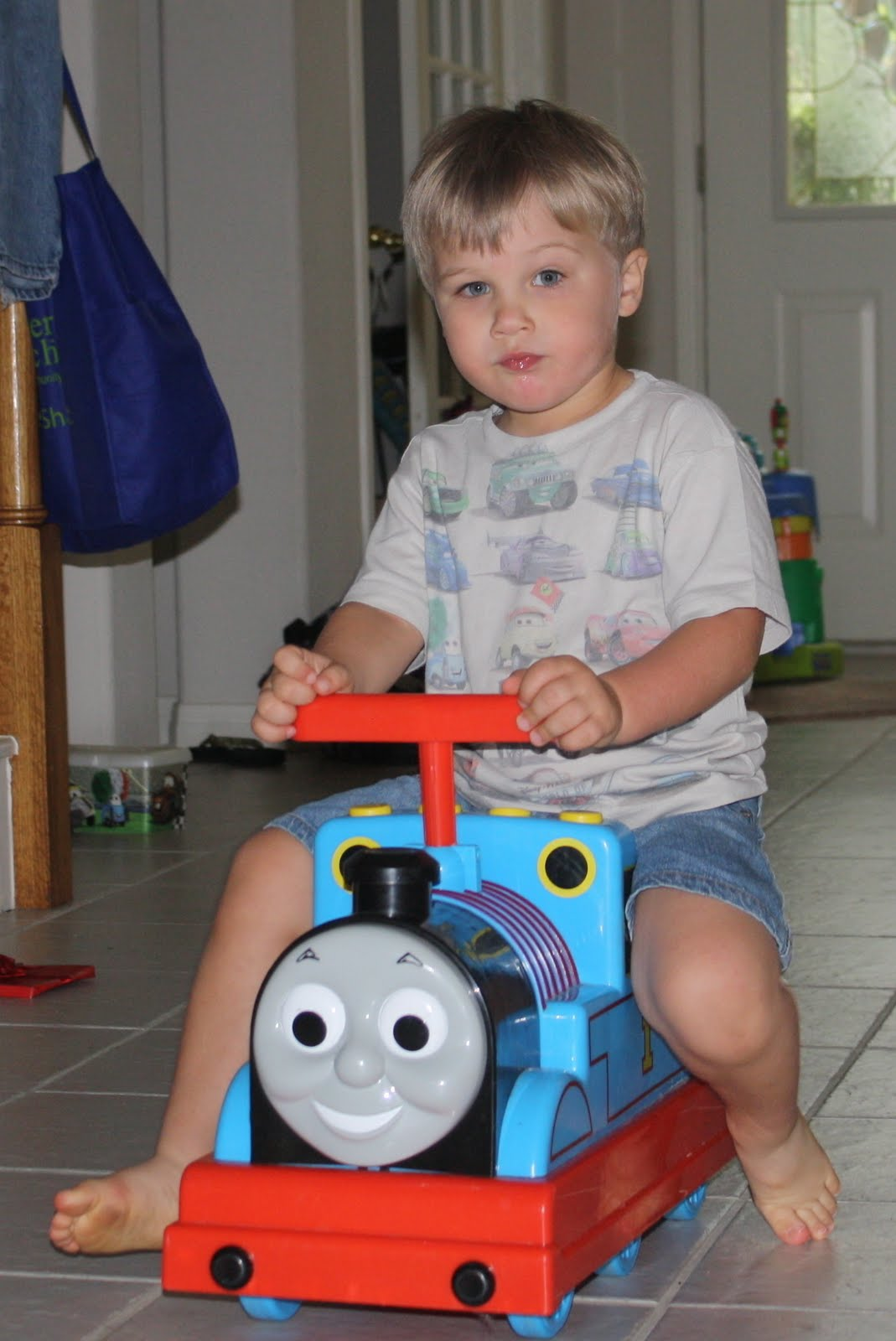 The Tackler loves his Thomas vehicle - perfect for ramming the walls or his sister.