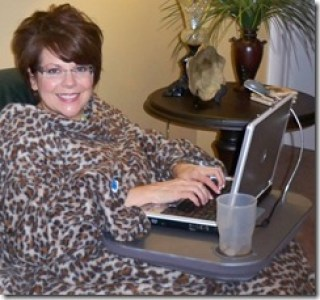 Facebooking in the Snuggie with the Laptop desk