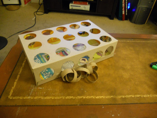 horizontal view of peek a prize cardboard toy box