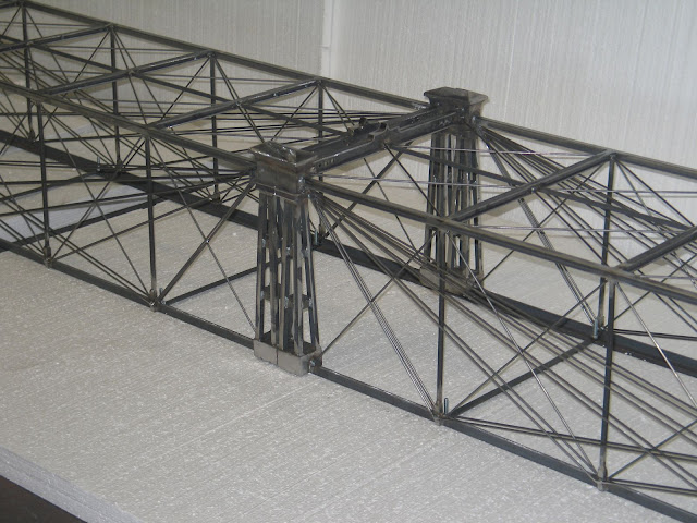 the bridge will get powder coated and after it is installed it will be painted as the original red with white accents it should be a nice bridge to look
