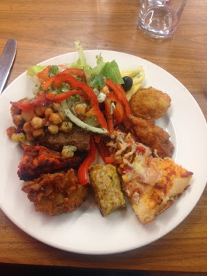 Pizza and Asian fusion starters at Sanam with salad