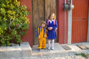 Alex making funny faces and Nadia, in their new uniforms in front of our house in San Miguel de Allende, Mexico before going to school.