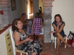 Agnieszka and Blanca working on their vino tinto (red wine).playing Twister with the kids.