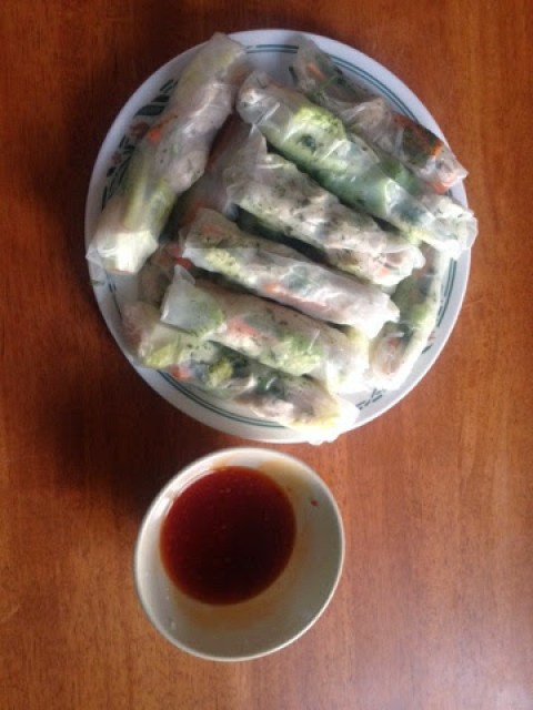 A pile of summer Vietnamese summer rolls with sweet chilli dip