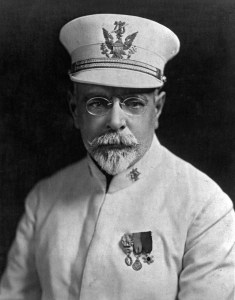 Photo of John Philip Sousa wearing a white uniform and white hat.