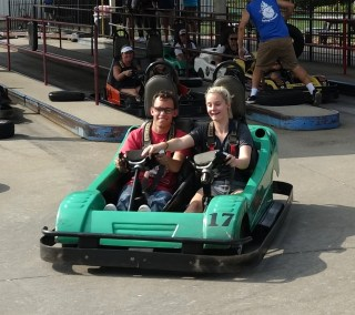 A SOAR participant navigates a bumper car around a track during a visit to Swing Around Fun Town.