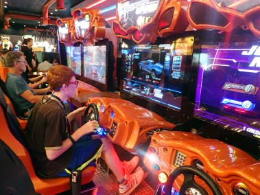 A SOAR participant attempts to win prizes while playing a video game at Dave and Busters.