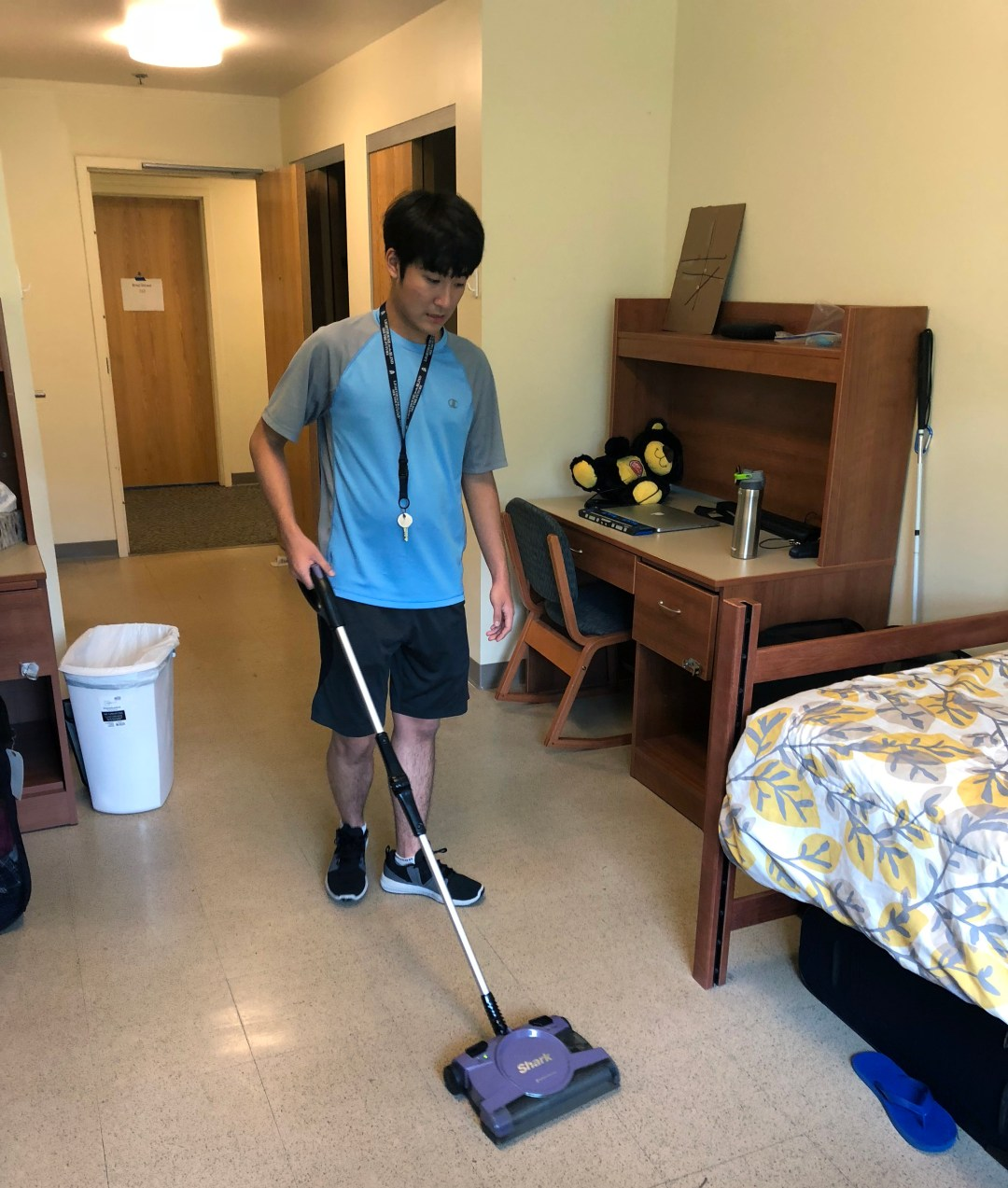 Seyoon Vacuums His Dorm Room As Part Of His Evening Chores.