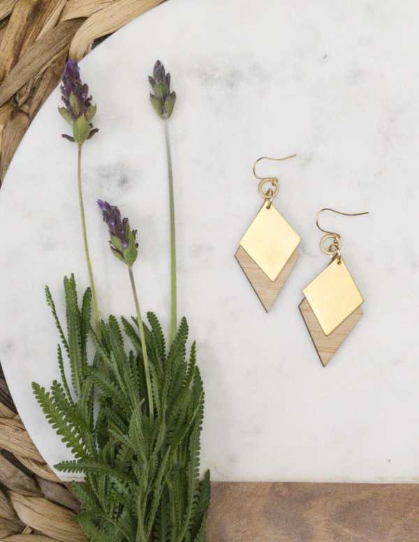 brass and bamboo earrings on marble
