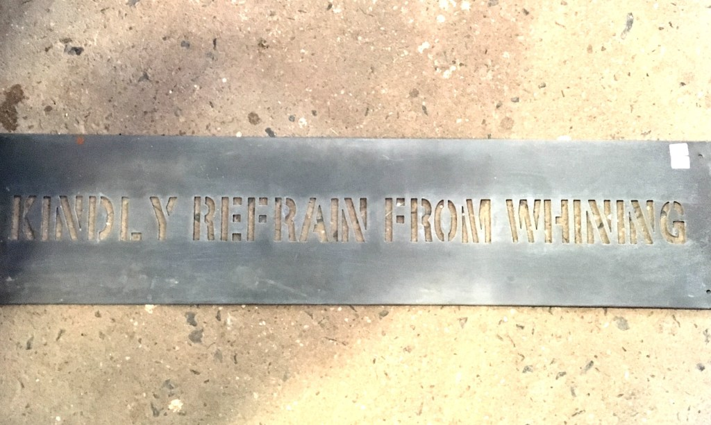 "metal laser cut sign that reads ""kindly refrain from whining"""