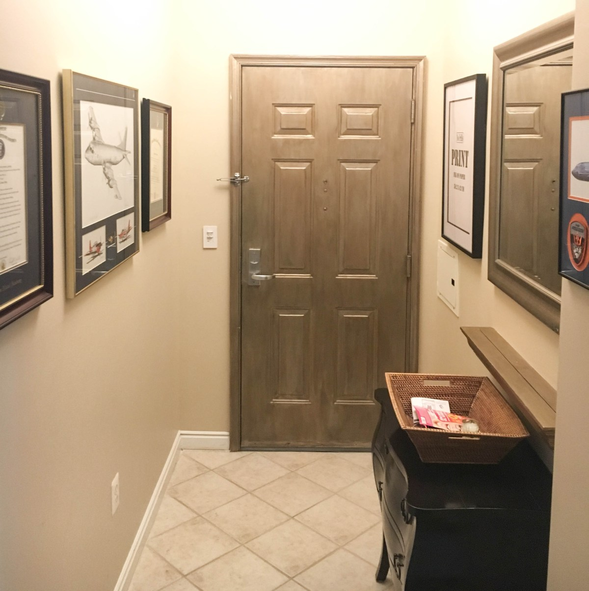 A before image of an apartment's front entryway without any Halloween decor.