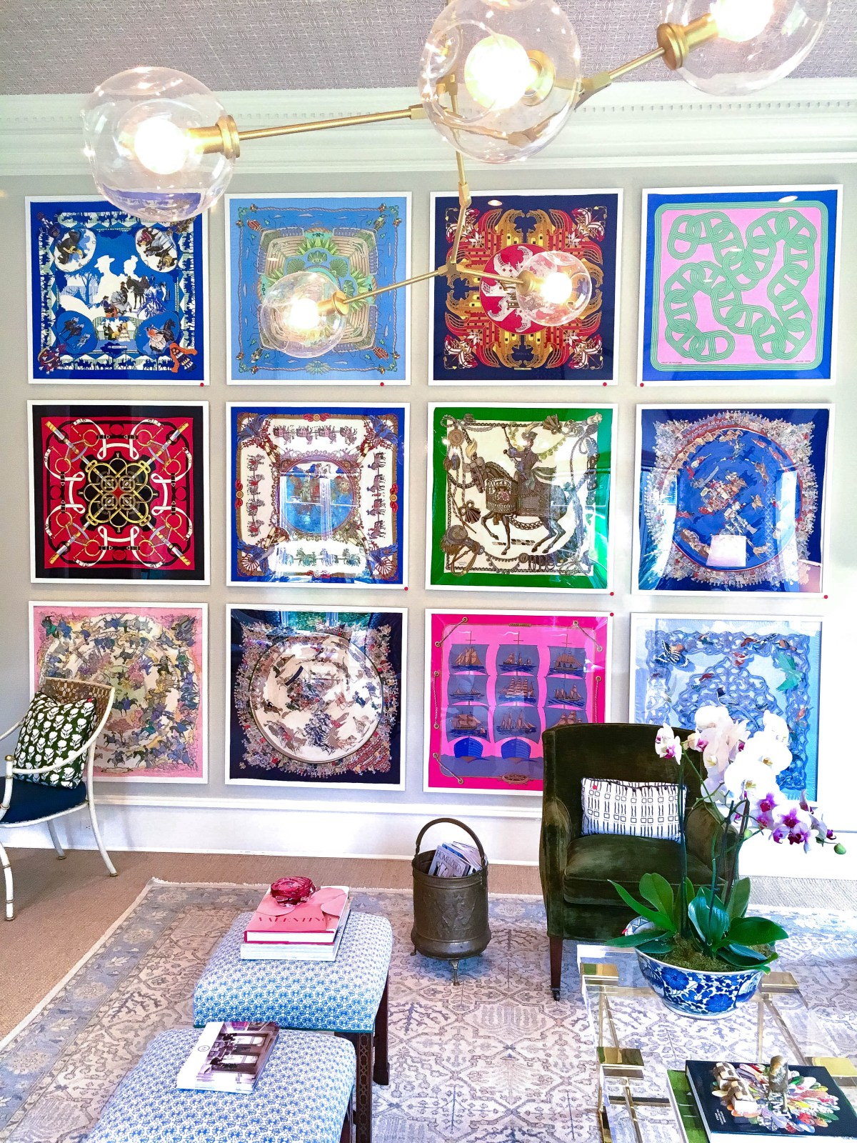 A colorful installation of twelve Hermes scarves with matching white framing creates an eye-catching art display in this ladies lounge.