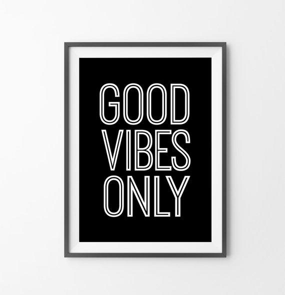Framed black art print with white lettering that reads Good Vibes Only