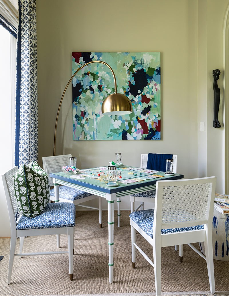 A large abstract painting by DC artist Lanie Mann is the stunning backdrop for a game table in the corner of this impeccably designed ladies' retreat.