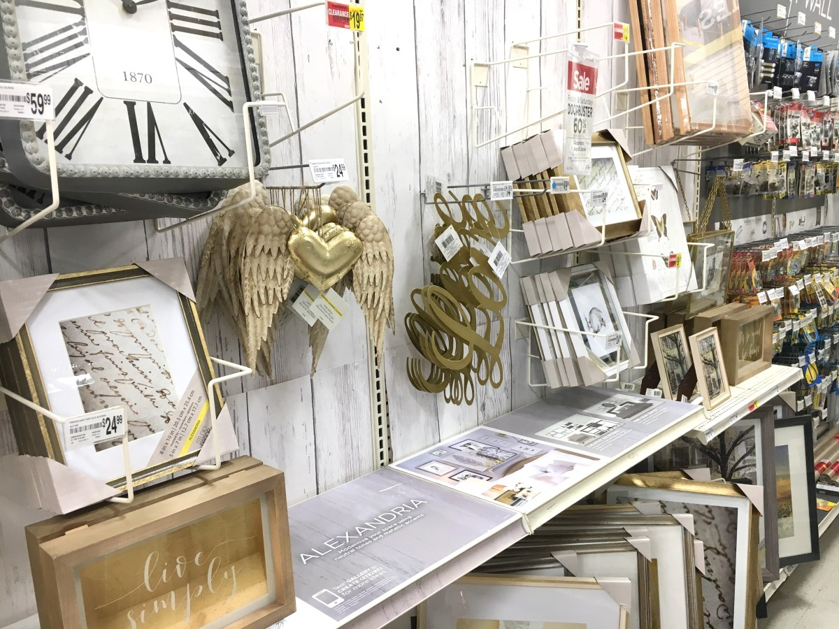 An aisle at Michaels craft store with readymade frames, wall decor, and hanging supplies