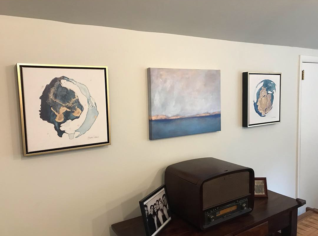 Painting of Ocean Landscape and Blue & Gold Abstract Art on Wall
