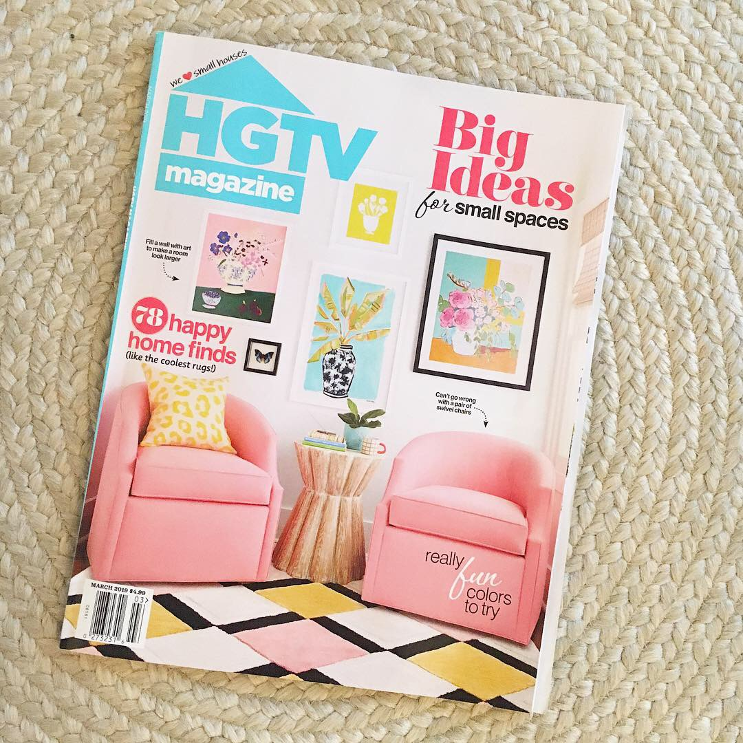 The cover of the March 2019 issue of HGTV magazine has a springtime feel, featuring a sitting area that incorporates pinks, blues, and yellows into the design scheme.