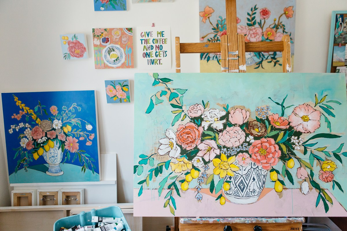 Jennifer Allevato's studio is filled with her paintings of colorful floral compositions.
