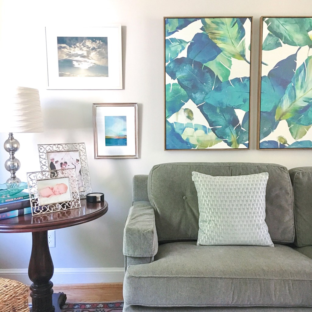 The lively palm leaf print in this framed wall canvas set from Target features beautiful, bold blue and green hues.