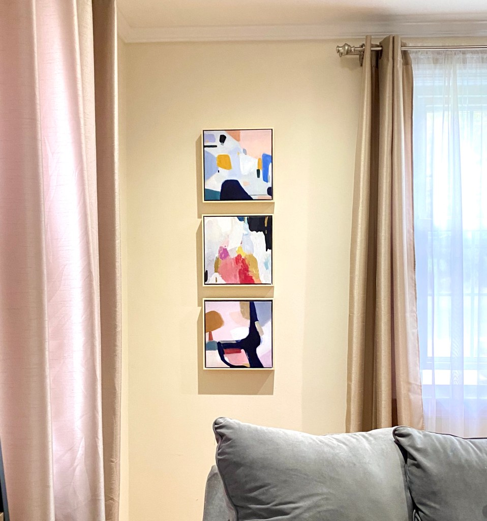 Decorate your walls with this assortment of 3 framed colorful abstract paintings from Target.
