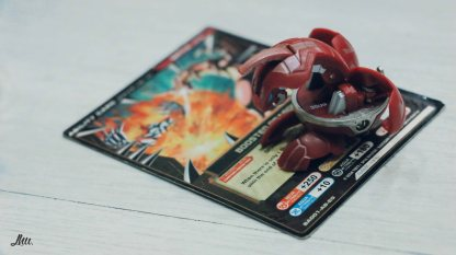 A Bakugan opens when it touches a magnetic surface.
