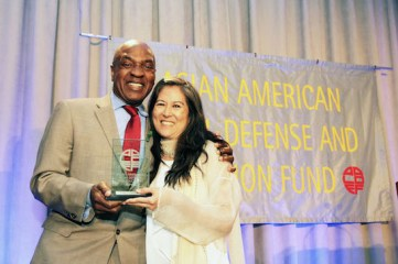 Charles Ogletree, Jr. presented the 2014 Justice in Action Award to Mari Matsuda. Photo by Lia Chang
