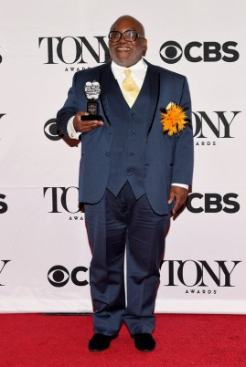 NEW YORK, NY - JUNE 07: Corey Mitchell of the Northwest School of the Arts, winner of the Excellence in Theatre Education Award, poses in the press room at the 2015 Tony Awards on June 7, 2015 in New York City. (Photo by Andrew H. Walker/Getty Images for Tony Awards Productions)