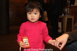 Fans of the Pocket Chinese Almanac come in all sizes. Photo by Lia Chang