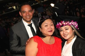 Carlos Flores and Marissa Chang-Flores with their daughter Asia Flores at the 2016 FIDM Graduation at the Staples Center in LA on June 20, 2016. Photo by Lia Chang