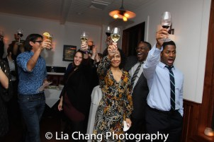 Rachel Leslie, Danny Johnson, and Wayne T. Carr raise a glass at the opening night celebration at Atelier Florian. Photo by Lia Chang