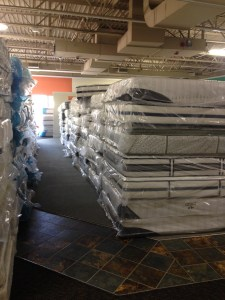 Stack of overstock mattresses in storage in Metro-Detroit