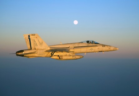 "070827-N-6346S-705 IRAQ (Aug. 27, 2007) - An F/A-18C Hornet, assigned to the ""Knighthawks"" of Strike Fighter Squadron (VFA) 136, heads home during sunset over Iraq after completing a close air support mission in support of U.S. and coalition ground forces. VFA-136 is assigned to Carrier Air Wing (CVW) 1 embarked aboard nuclear-powered aircraft carrier USS Enterprise (CVN 65). Enterprise Carrier Strike Group is on a scheduled deployment in support of maritime operations and the global war on terrorism. U.S. Navy photo by Lt. Peter Scheu (RELEASED)"