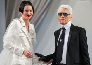 kendall-jenner-presents-a-creation-by-german-designer-karl-lagerfeld-as-part-of-his-haute-couture-fall-winter-20152016