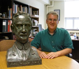 Mark Palkovic, Head of the CCM Library, with the bust of Pietro Floridia