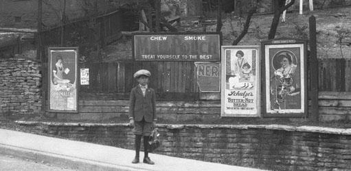 Boy in front of Billboards