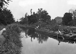 Boys Rowing in Water