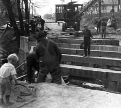 Child standing next to work site