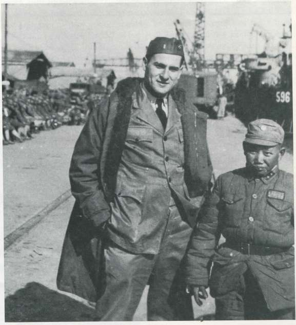 Dr. Heimlich and a Chinese soldier pose for a snapshot on the Shanghai waterfront
