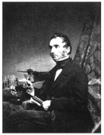 Justus von Liebig (1803-1873) posing with his apparatus for combustion analysis.