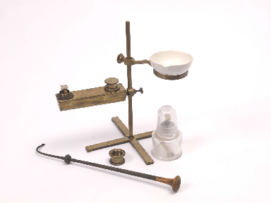 A portable Berzelius oil lamp for blowpipe analysis. The additional ring and alcohol lamp could be used to evaporate mineral water samples for analysis.