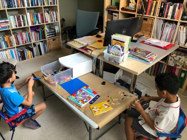 Two boys playing legos.