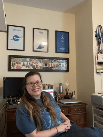 Kellie sitting at her desk.