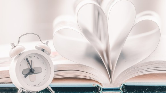 clock and open book