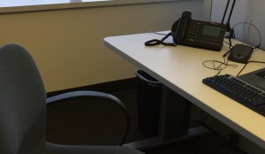 empty chair, phone, keyboard at office