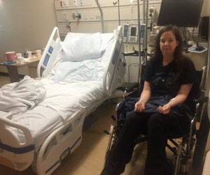 Libby in wheelchair in hospital room